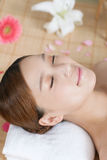 A young woman enjoying spa. At beauty salon, indoors Stock Image