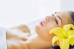 Young woman enjoying at spa, looking away Stock Image