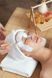 A young woman enjoying spa mask. A young women enjoying spa mask at beauty salon, indoors Stock Photo