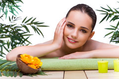 The young woman enjoying spa treatment Royalty Free Stock Images