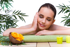 The young woman enjoying spa treatment Stock Photography