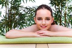 The young woman enjoying spa treatment Royalty Free Stock Image