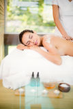 Young woman enjoying spa treatment Royalty Free Stock Image