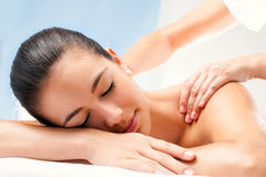 Young woman enjoying spa treatment. Royalty Free Stock Photos