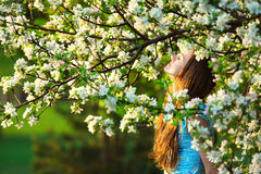 Young woman enjoying spring blossom Stock Photography
