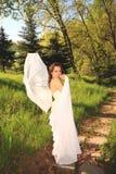 Young woman enjoying Spring Sun Stock Images