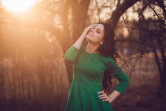 Young woman enjoying the spring sunset. Beauty girl outdoor. freedom concept Royalty Free Stock Photo