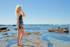 Young woman enjoying summer at beach Stock Images