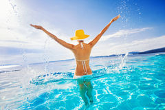 Young woman enjoying summer. Beautiful girl enjoying a sun in the infinity pool. Vacations and summer concept Royalty Free Stock Images