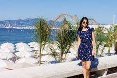 Young  woman enjoying the summer in Cannes france. Smiling  young woman posing for photo on the beach in Cannes ,France Royalty Free Stock Photos
