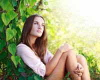 Young woman enjoying summer day in the garden Royalty Free Stock Photo