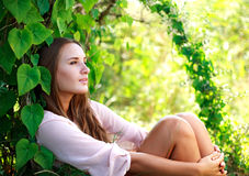 Young woman enjoying summer day in the garden Royalty Free Stock Image
