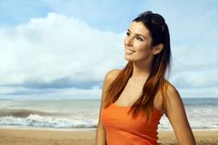 Young woman enjoying summer sun on the beach Stock Photography