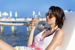 Young  woman enjoying the summer vacation with gin cocktail in the hand Royalty Free Stock Photography
