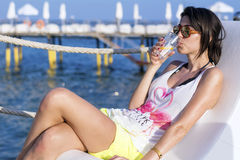 Young  woman enjoying the summer vacation with gin cocktail in the hand Stock Photo