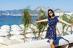 Young  woman enjoying the summer view  in Cannes france Stock Photo