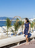 Young  woman enjoying the summer view  in Cannes france Royalty Free Stock Photography