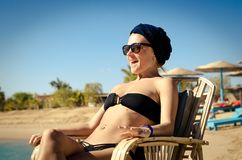 Young woman enjoying sun at the beach Royalty Free Stock Images