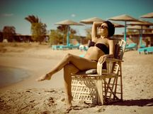 Young woman enjoying sun at the beach Royalty Free Stock Photography