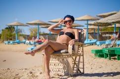 Young woman enjoying sun at the beach Stock Photo