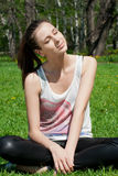 Young woman enjoying the sun in park Royalty Free Stock Photos