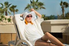 Young woman enjoying sun Stock Photo