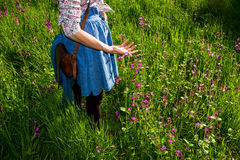 Young woman enjoying sunny day in a field Royalty Free Stock Images