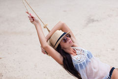 Young woman enjoying a sunny day in the hammock Royalty Free Stock Photography
