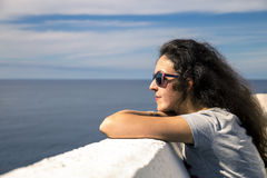 Young woman is enjoying the sunny day on the seaside royalty free stock images