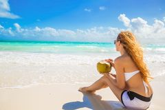 Young woman enjoying sunny day on tropical beach stock image