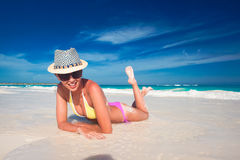 Young woman enjoying sunny day at tropical beach Stock Image