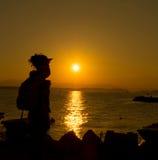 Young woman enjoying sunset Stock Photography