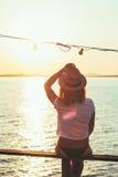 Young woman enjoying sunset Royalty Free Stock Photos