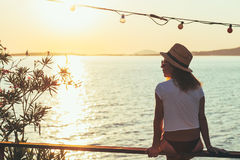 Young woman enjoying sunset stock photo
