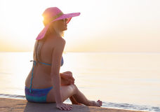 Young woman enjoying sunset at the beach Stock Images
