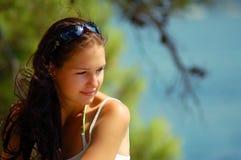 Young woman enjoying sunshine. A beautiful young woman enjoying the sunshine on a beach at summer Stock Images