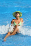 Young woman enjoying a swimming pool Stock Photography