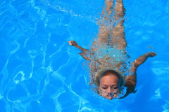 Young woman enjoying a swimming pool Stock Photo