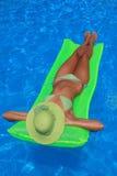 Young woman enjoying a swimming pool Royalty Free Stock Photos