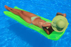 Young woman enjoying a swimming pool Stock Images
