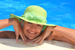 Young woman enjoying a swimming pool Royalty Free Stock Photography