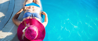 Young woman enjoying a swimming pool Royalty Free Stock Images