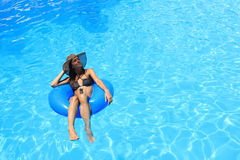 Young woman enjoying the swimming pool Royalty Free Stock Photography