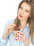 Young Woman Enjoying Tea and Biscuits Stock Photos