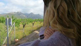 A young woman enjoying traveling on an old train, admiring beautiful tourist locations stock footage