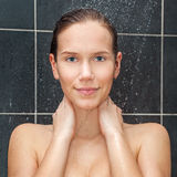 Young beauty under shower Royalty Free Stock Photography