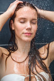 Young beauty under shower Royalty Free Stock Image