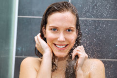 Young beauty under shower. Young woman enjoying under shower Royalty Free Stock Photo