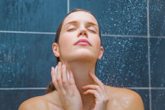 Young beauty under shower. Young woman enjoying under shower Royalty Free Stock Images