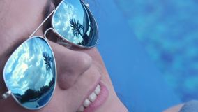 Young woman enjoying vacation at luxury resort with exotic beach. Stock footage stock video footage